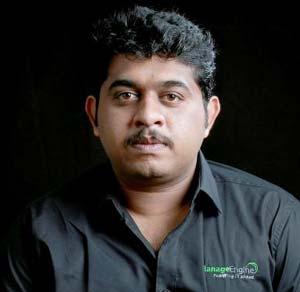 A corporate headshot of Muraleedharan Sadhasivam