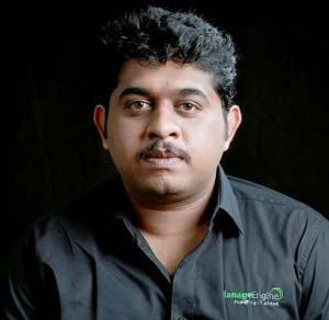 A corporate headshot of Muraleedharan Sadhasivam